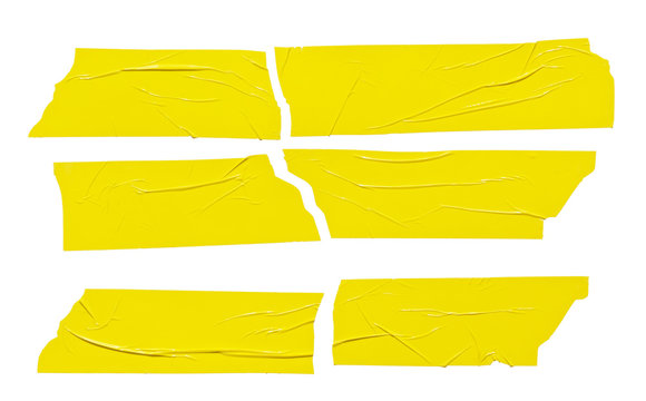 Set of yellow tape pieces isolated on white background. Grunge yellow color crumpled plastic stickers