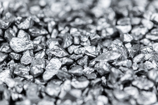 Heap of silver nuggets as background or texture