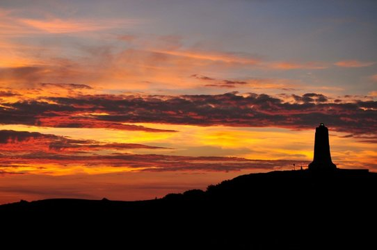 Low Angle View Of Wright Brothers National Memorial On Silhouette Hill During Sunset