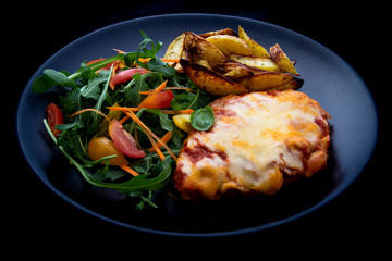 Chicken Parmesan Baked in Tomato Sauce with cheese, chips