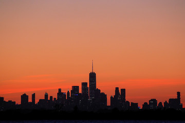 One World Trade Center and the lower Manhattan skyline are seen shortly after sunset from the Rockaway section of Queens, New York