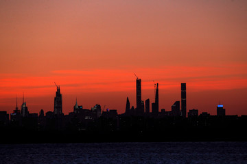 The midtown Manhattan skyline is seen shortly after sunset from the Rockaway section of Queens, New York