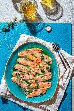 Latin American and Italian dish Crudo de Salmon. Raw Salmon marinated in lemon juice and spices. Top view