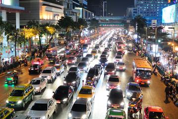 View Of City Street Lit Up At Night - fototapety na wymiar