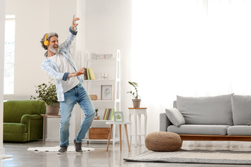 Cool senior man dancing at home