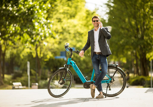 Young businessman on the Kettler Quadriga CX10 ebike with mobile phone