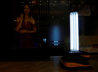 An autonomous mobile robot that disinfects surfaces with ultraviolet light, known as Sunburst UV Bot, is deployed at Northpoint City shopping mall amid the coronavirus disease (COVID-19) outbreak in Singapore