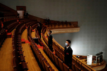Security personnel keep watch at the opening session of CPPCC in Beijing