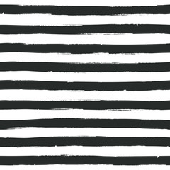 Wavy stripes seamless black and white background. Thin hand drawn uneven waves pattern. Striped abstract template. Cute streaks texture. Grunge distressed design. Vector illustration