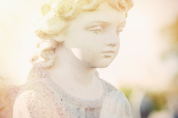 Fotomurales - Close up guardian angel of children as symbol of love, faith, hope and good.
