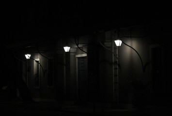 Illuminated Street Light Outside Houses In Dark At Night Fotomurales
