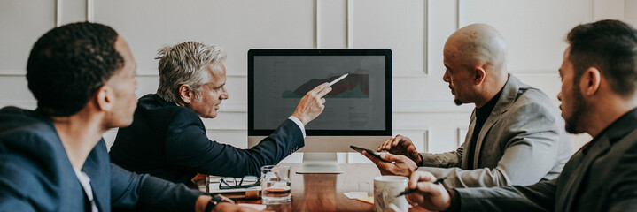 Board of director discussing business growth in computer