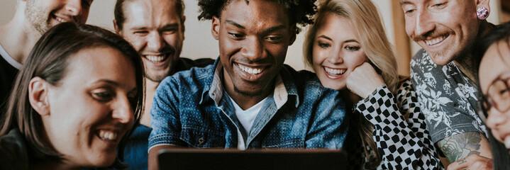 Diverse people using a digital tablet together