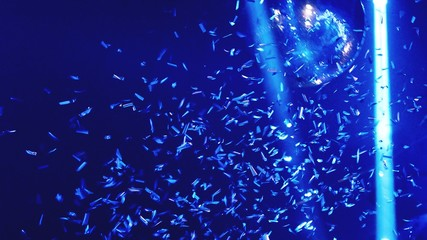 Low Angle View Of Confetti Against Disco Ball