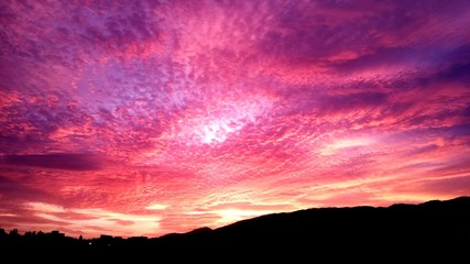 Wall Murals Candy pink Low Angle View Of Cloudy Sky At Sunset