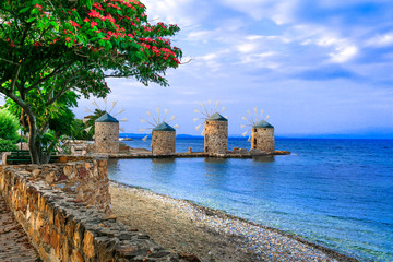 Authentic traditional Greece scenery - old windmills near the sea - landmark of Chios island