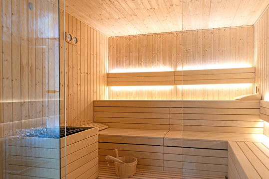 Empty interior of traditional Finnish sauna room. Modern wooden spa therapy cabin with hot dry steam
