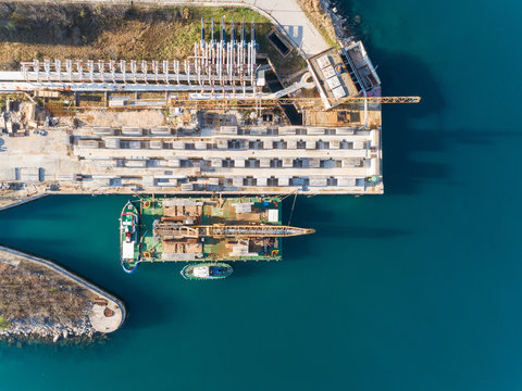 Aerial view of boats at the construction of future LNG terminal on the shore of the bay in Omisalj, Croatia