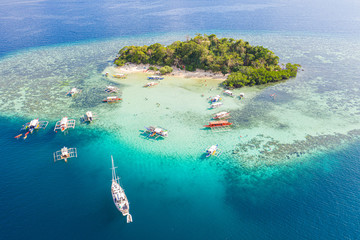 Aerial view of  CYC Beach with Boats in Foreground,Coron,Palawan, Philippines.