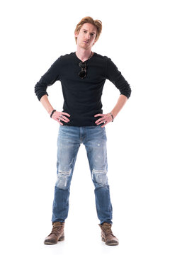 Serious young elegant handsome red hair man with hands on hips looking at camera. Full body length isolated on white background.