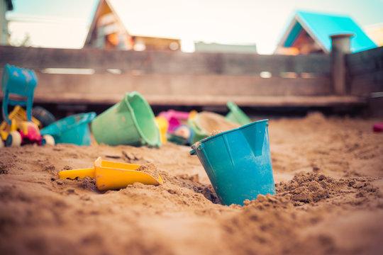 Childhood sandbox concept: Close up of plastic toy bucket