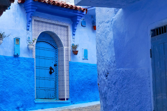 Entrance to the one of the old houses in Medina of Chefchaouen (Chaouen), Morocco. The city is noted for its buildings in shades of blue and that makes Chefchaouen very attractive to visitors.