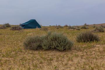 Tent in Karakum desert near Darvaza (Derweze) gas crater (Door to Hell or Gates of Hell) in Turkmenistan