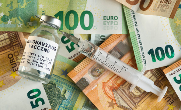 Coronavirus Covid-19 vaccine price / cost concept - glass vial with silver cap on pile of euro bank notes, syringe near, closeup detail (own sticker design with dummy data - not real product)