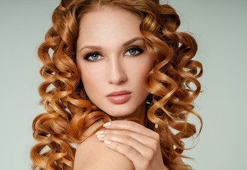 Portrait of woman with long curly beautiful red hair. Long Curly Red Hair. Fashion Woman Portrait