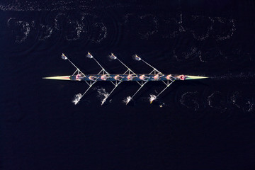 Elevated view of female's rowing eight in water