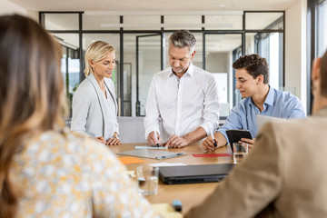 Businesswoman and businessman leading a meeting in office