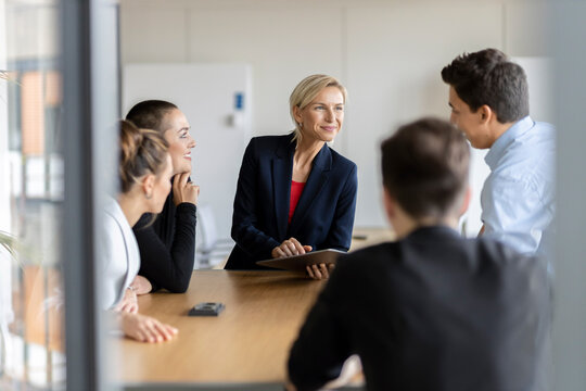 Businesswoman leading a meeting in office