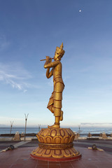 Foto op Plexiglas Historisch mon. Portrait view of the Rakhine Nyut Phu statue, with the sea in the background and a third-quarter moon in the sky, Sittwe, Rakhine, Myanmar (Burma), Asia