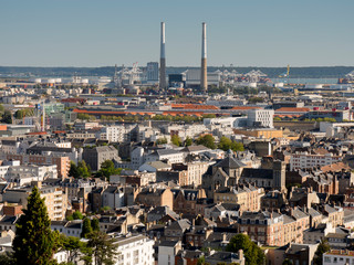 City skyline towards Seine estuary showing iconic twin chimneys, Le Havre, Normandy, France, Europe