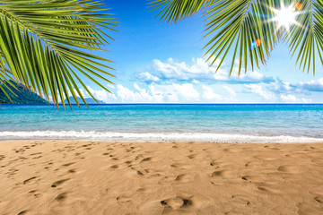 Beautiful beach by the clear sea on a beautiful sunny holiday day