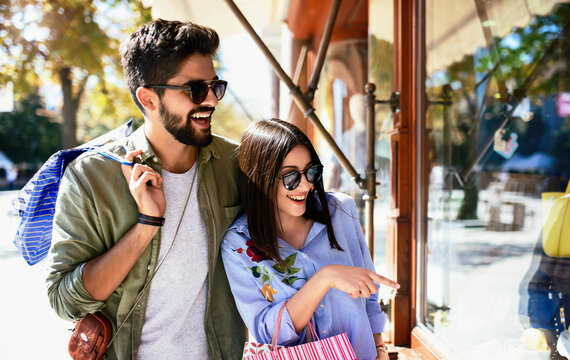 Attractive young couple enjoying in shopping. Consumerism, love, dating, lifestyle concept
