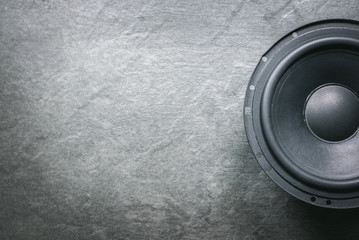 Photo sur Toile Magasin de musique A car audio loudspeaker on dark flat lay background.