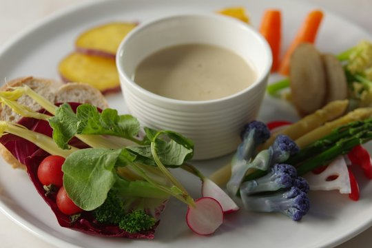 Fresh Vegetables Served With Bagna Cauda On Plate