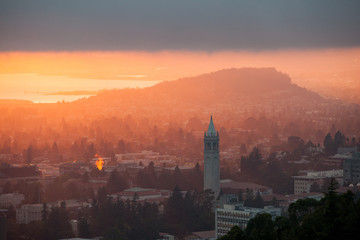A beautiful sunset occurs over the city and campus of Berkeley which lies on the east shores of San Francisco Bay in Northern California.