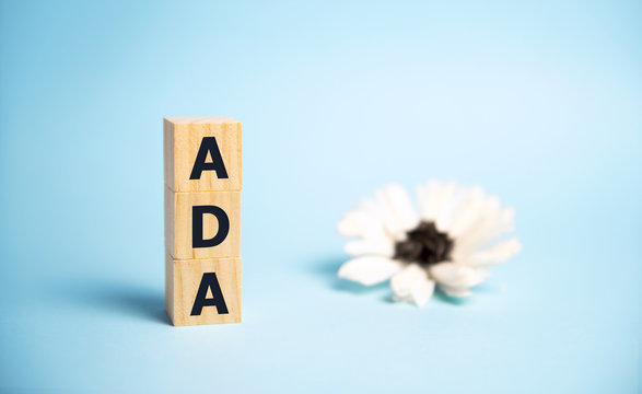 Word ADA Americans with Disabilities Act is made of wooden building blocks.