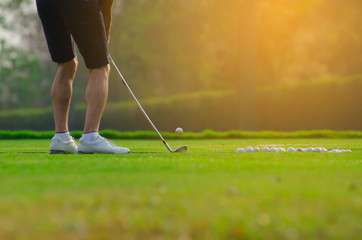 Fototapeta Low Section Of Man Playing Golf On Grassy Field During Summer obraz