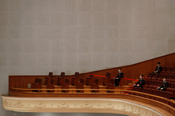Security personnel keep watch at the opening session of NPC in Beijing