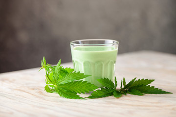 Cannabis herbal vegan gluten free lactose free milk and cannabis leaves.