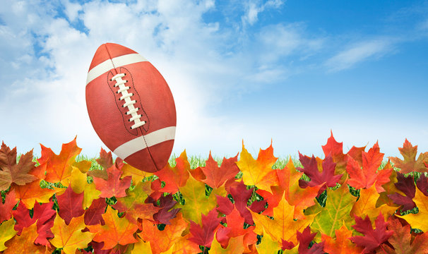 American Football Ball Over Autumn Leaves