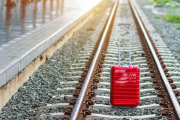 Close-up Of Wheeled Luggage On Railroad Tracks