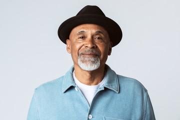 Happy senior man wearing a black hat