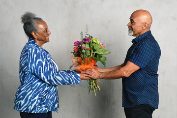 African American couple celebrating an anniversary together with flowers