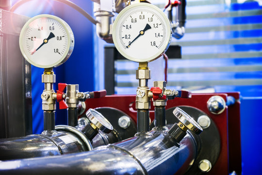 high pressure gauges installed on a water or gas system. Selective focus
