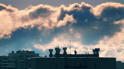 Fotobehang - Epic storm clouds moving over old tv antenna city skyline rooftop. Timelapse, 4K UHD.