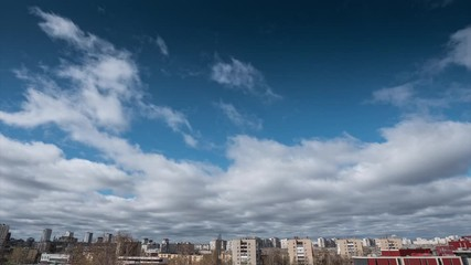 Fotobehang - White clouds moving fast over city skyline. Wide angle view, timelapse, 4K UHD.